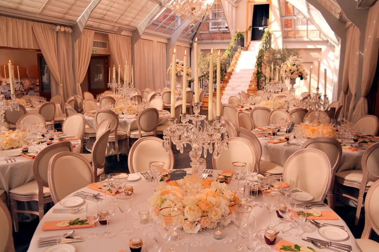 Ivory wall drapes plus crystal table candelabra with votive holders, pinspot lights to table centres and Louis chairs at Botleys Mansion, UK wedding venue