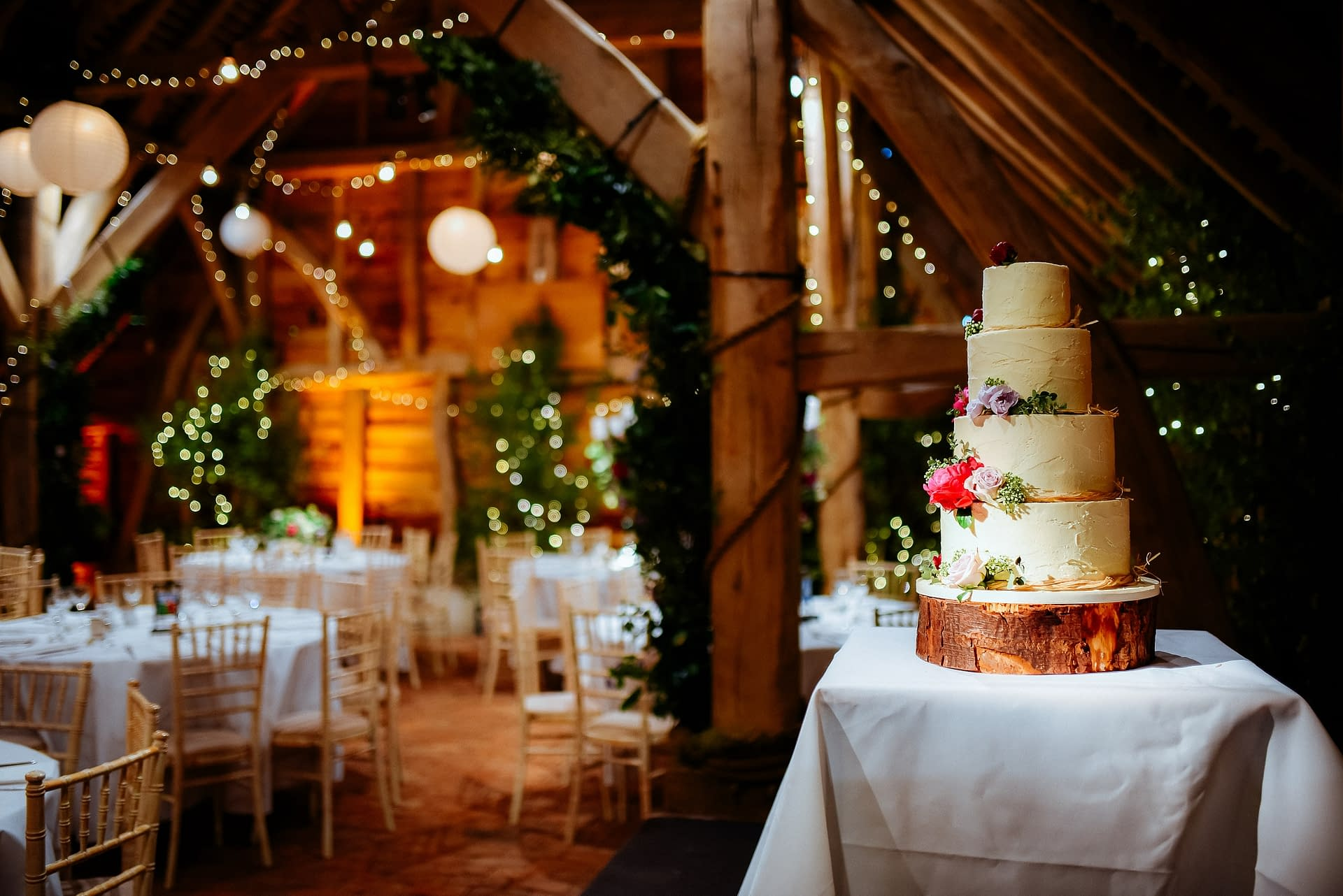 Festoon lighting with paper lanterns combined with birch trees and fairy lights at Gildings Farm, UK wedding venue