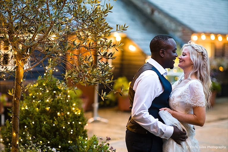 Fairy lights in trees and bushes at Upwaltham Barns, UK wedding venue