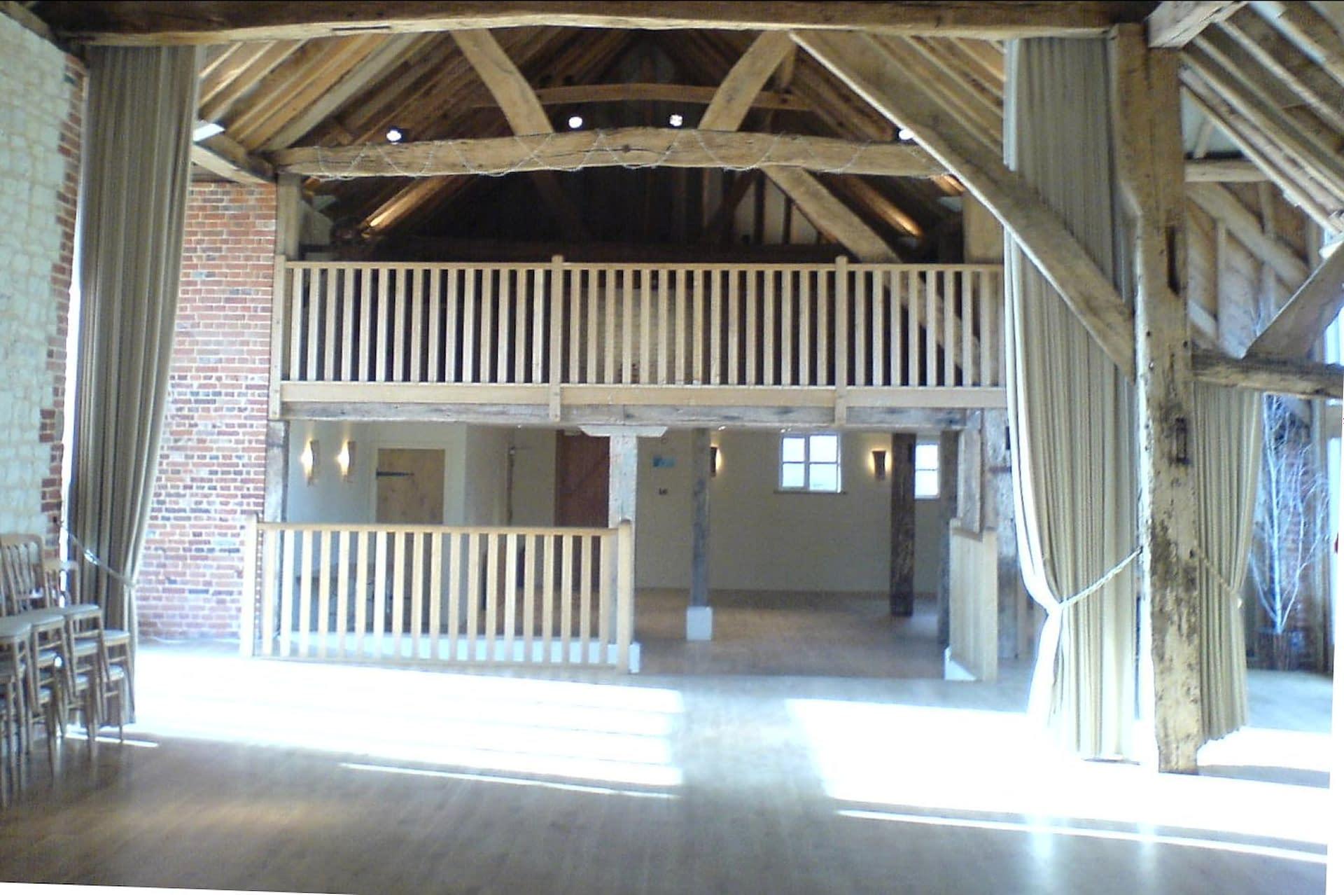 An un-decorated Bury Court Barn UK wedding venue awaiting party decorators
