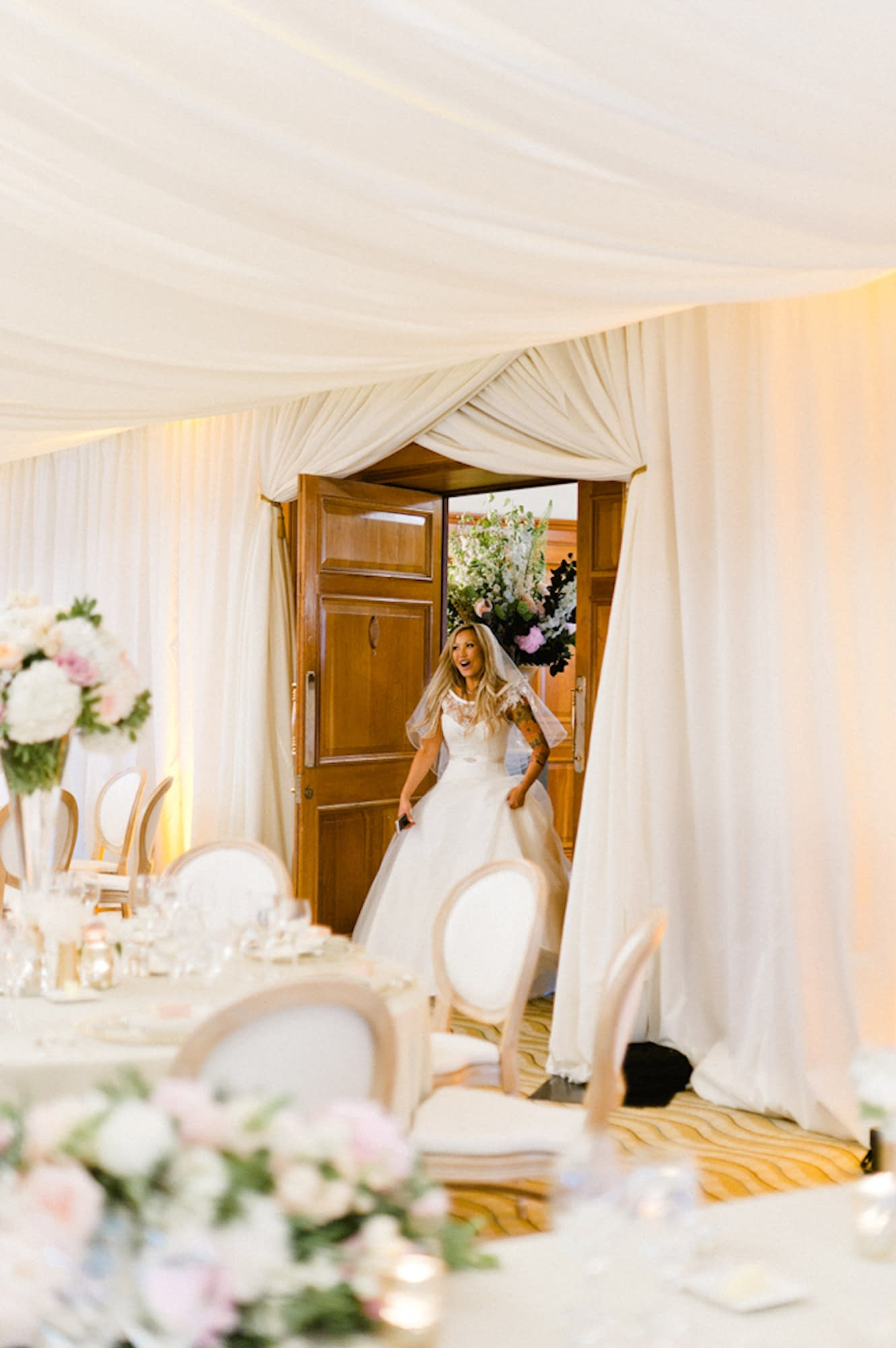 our bride seeing her beautiful soft ivory draping for the first time as part of her luxury wedding venue styling at pennyhill park hotel bagshot surrey uk
