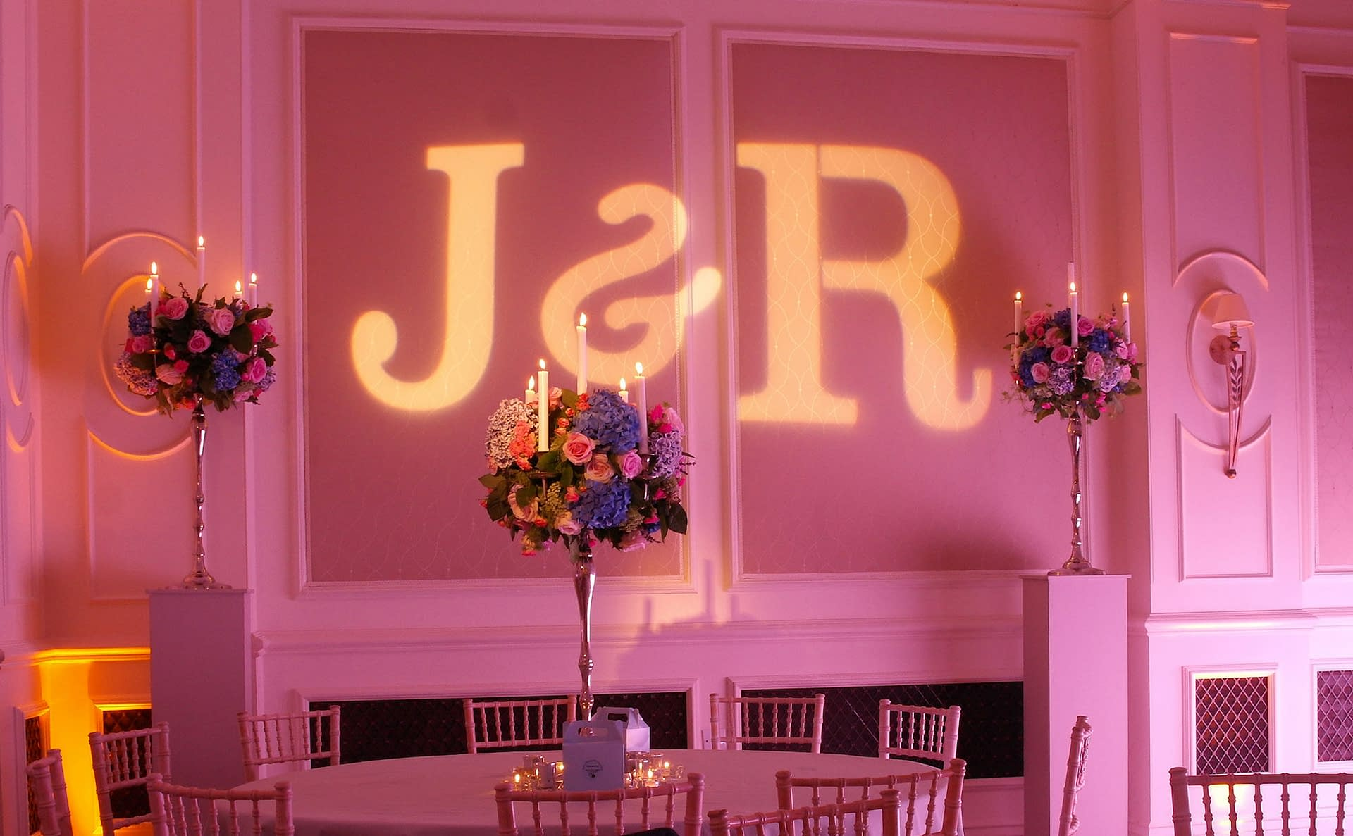 Mood lighting and wall projections at The Four Seasons Hook, UK wedding venue