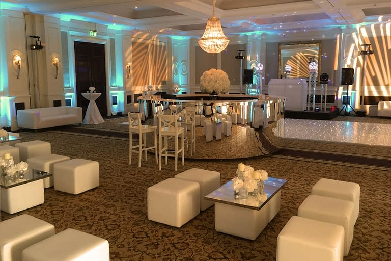 Chill-out furniture, chandelier, shard bar, poseur tables, mood lighting and starlit dance floor at Four Seasons Hotel Hook, UK wedding venue