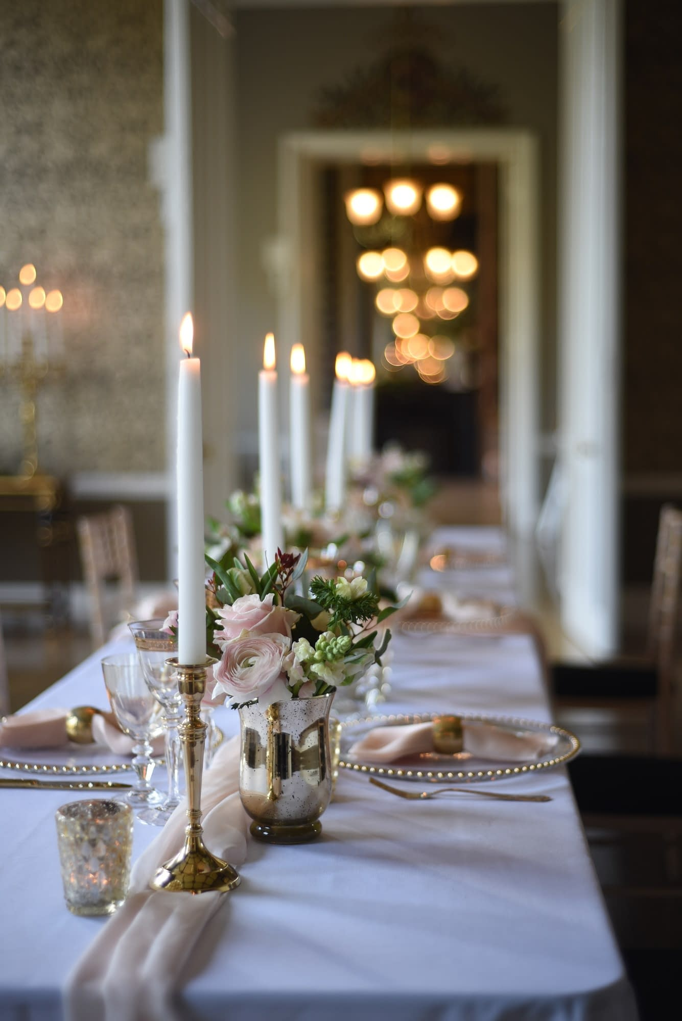 Brass table candlesticks at an elegant wedding at Nonsuch Mansion, UK wedding venue