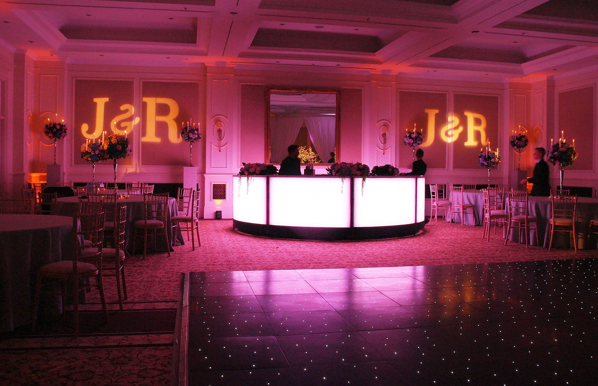 Mood lighting, illuminated dance floor and wall projections at The Four Seasons Hook, UK wedding venue