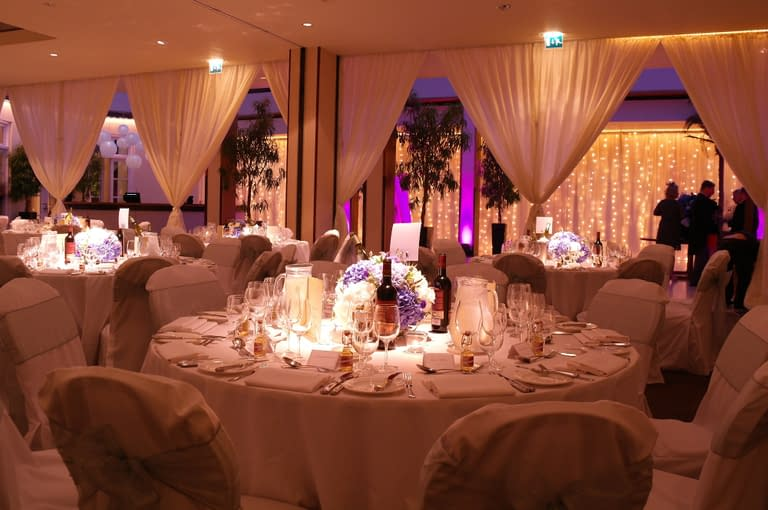 Stunning wedding design at Hurlingham Club London UK with partition drape, fairy light cascade, mood lighting