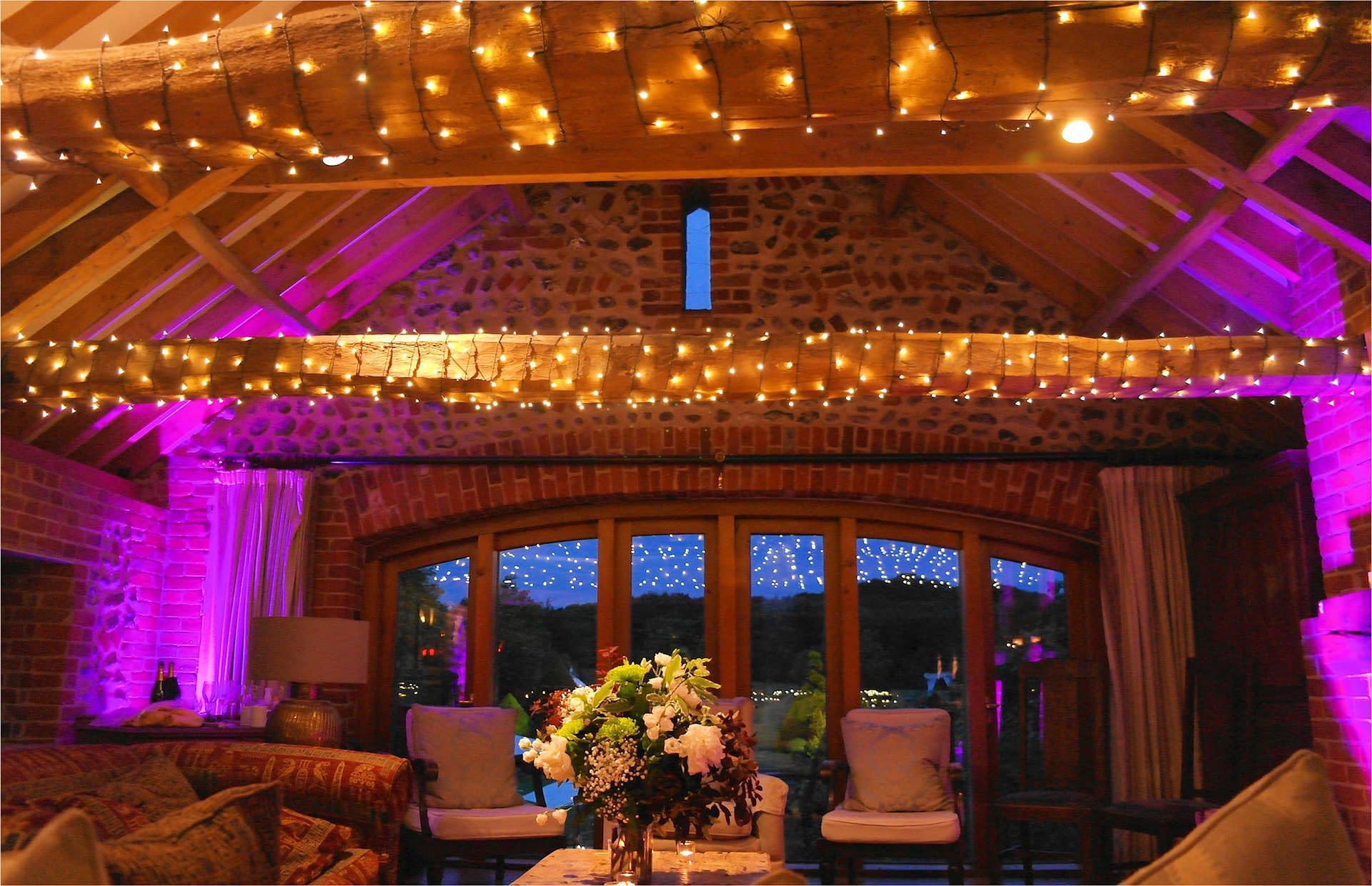 Fairy light decoration and mood lighting at Chaucer Barn, UK wedding venue