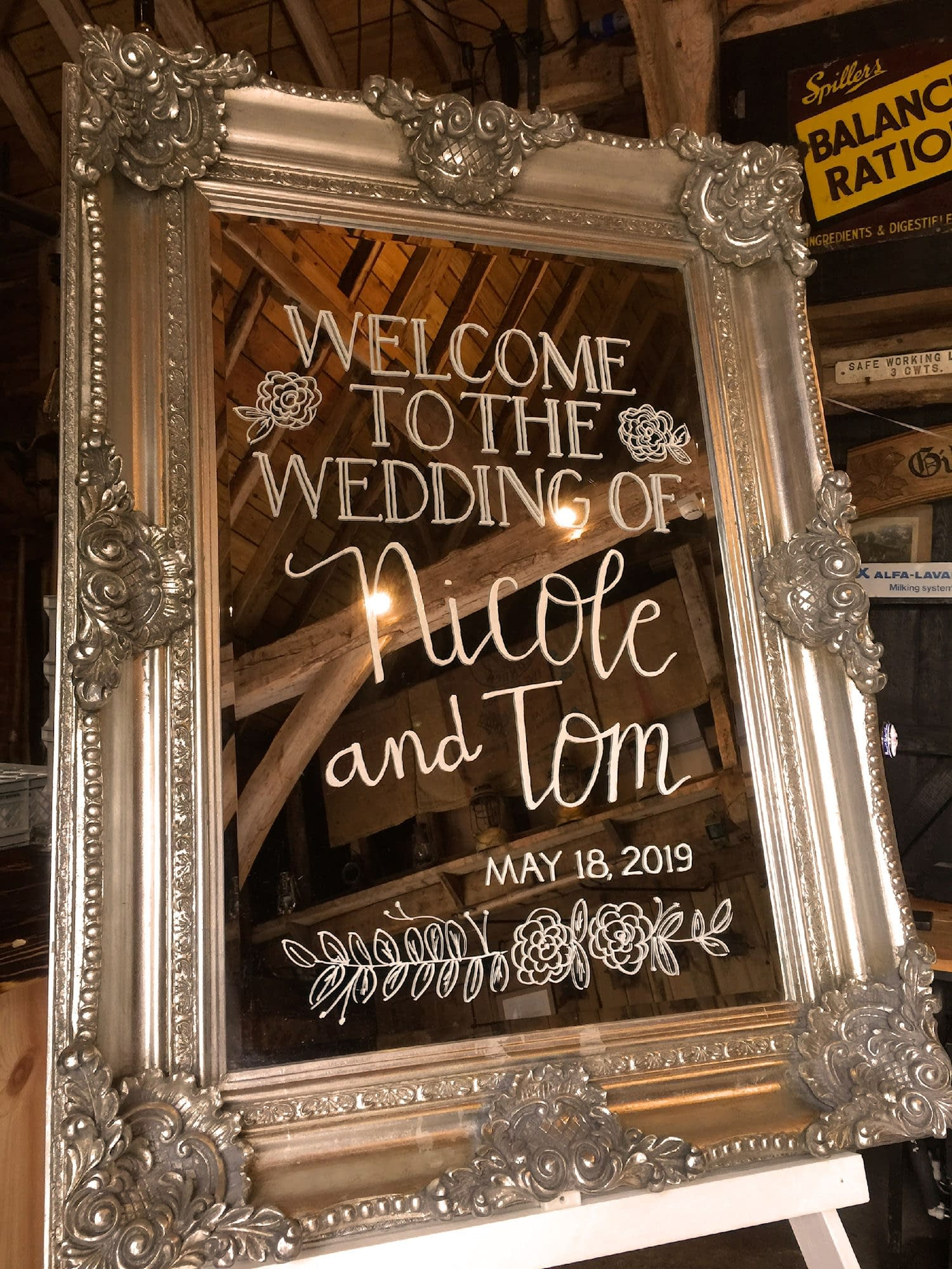 Bespoke silver mirror welcome sign at Gildings Barn, UK wedding venue.