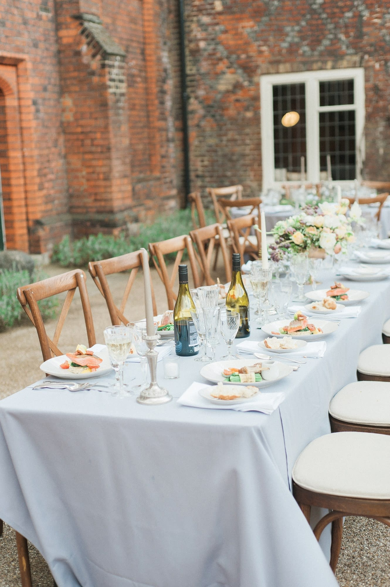 Rustic dining tables and cross-back chairs at a wedding photoshoot at Fulham Palace, UK wedding venue
