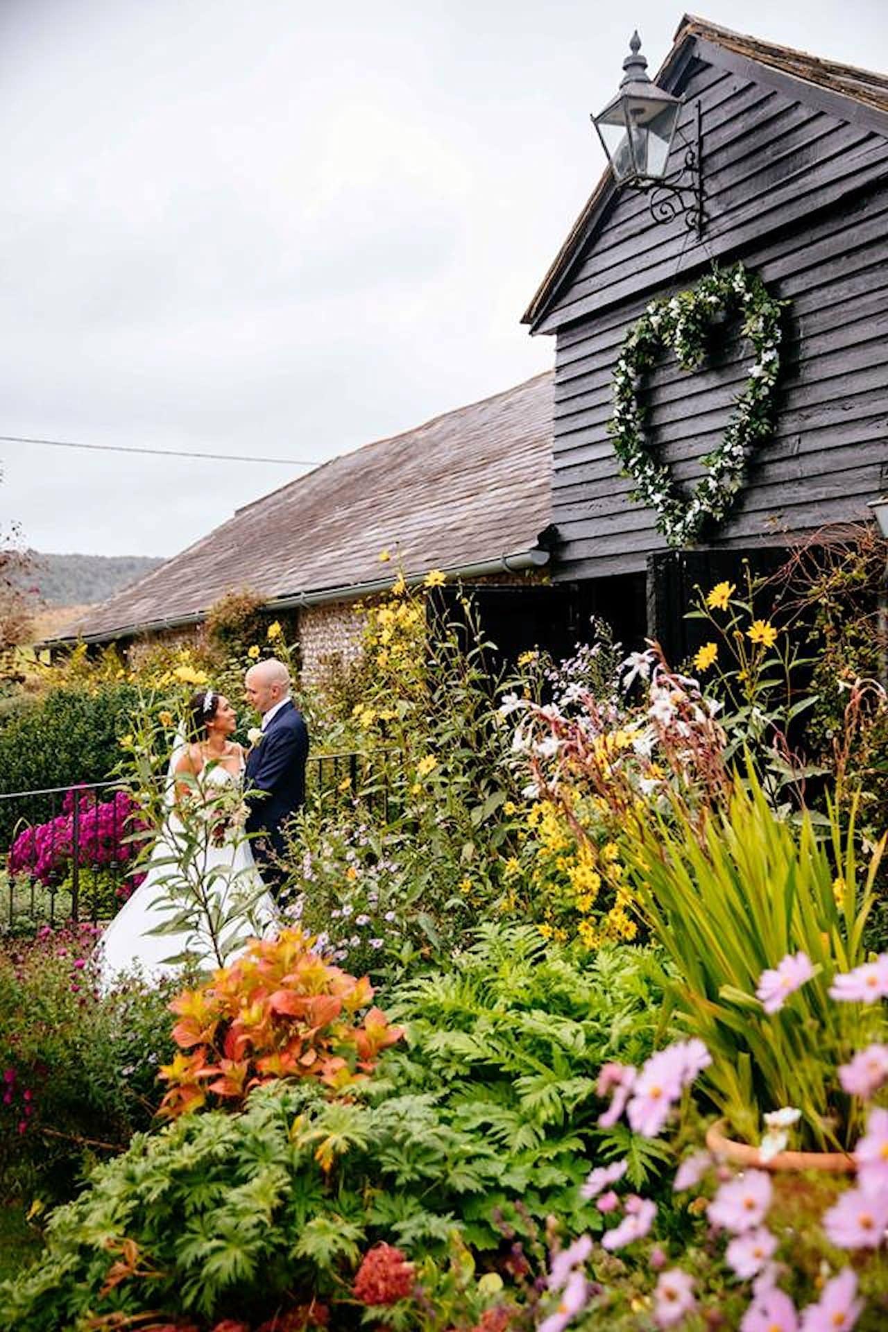 Large faux foliage heart at Upwaltham Barns, UK wedding venue