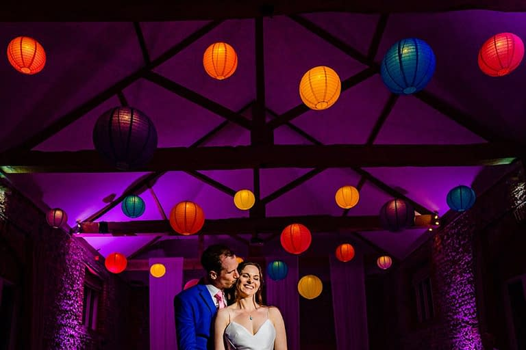 Overhead illuminated paper lanterns at Farbridge Barns, UK wedding venue