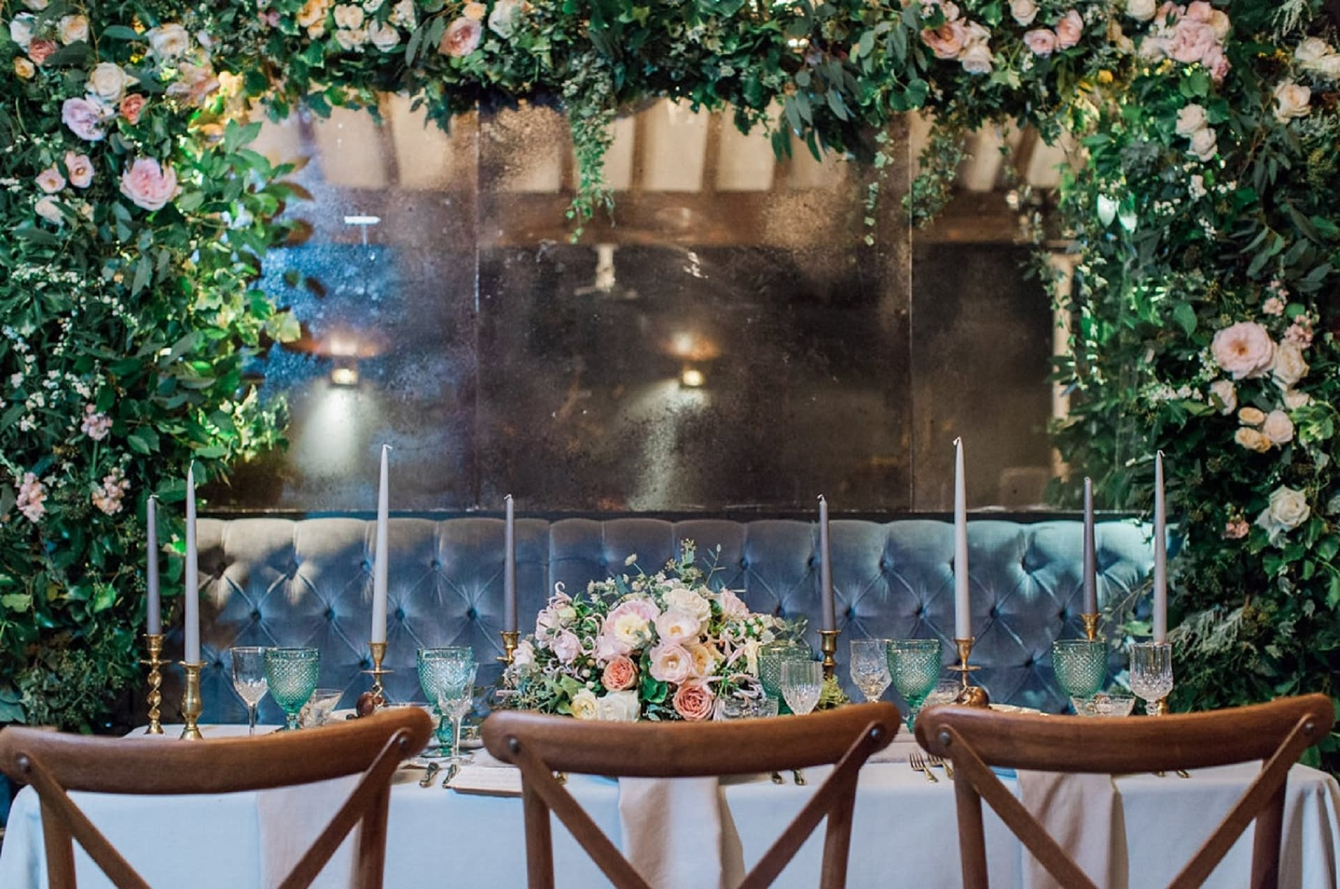 Rustic tables and cross-back chairs at the Dead Dolls House, London, UK wedding venue