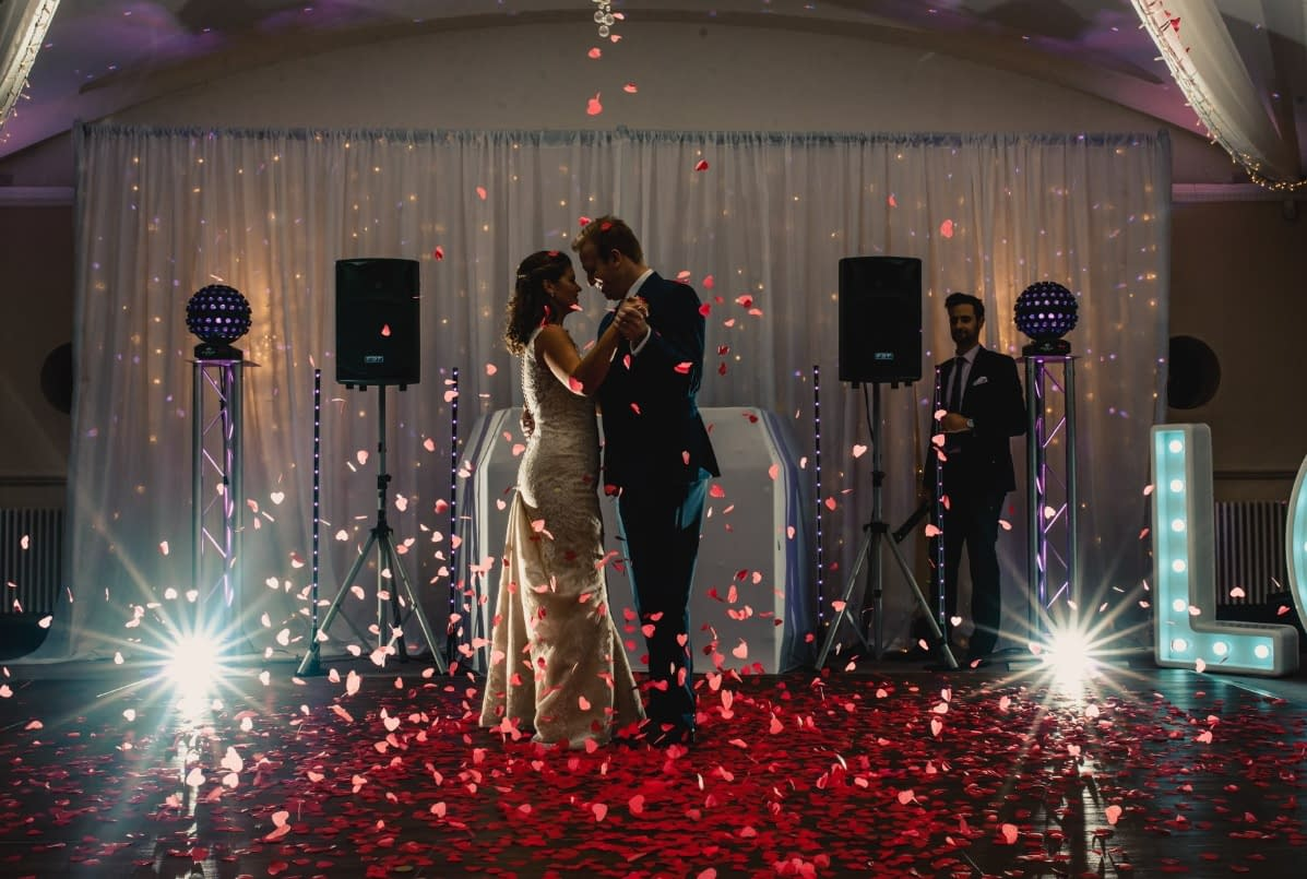 Ivory fabric and fairy light cascade backdrop at Silvermere Golf Club, Surrey wedding venue