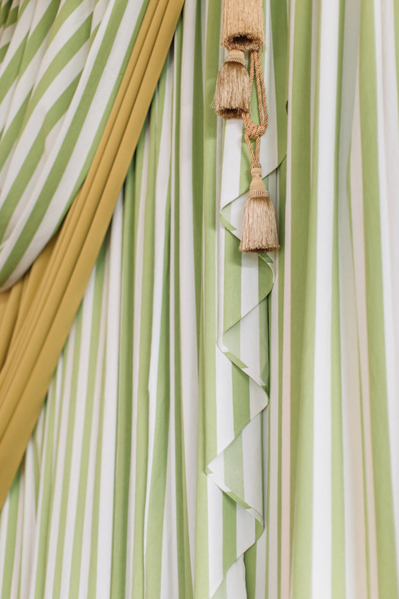 Bespoke backdrop in green and white stripes with mustard at Trinity Buoy Wharf London England