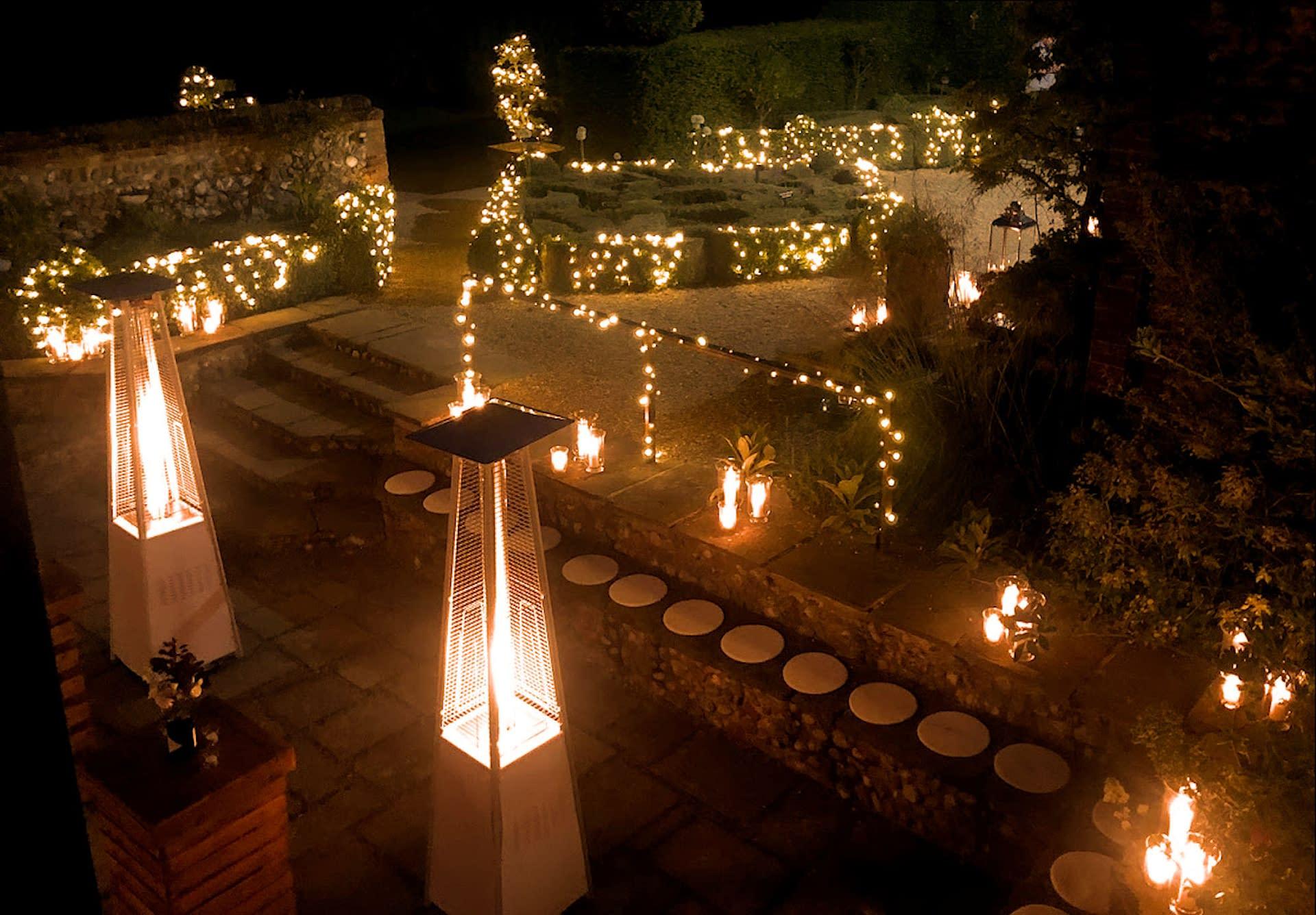 Fairy light, storm lantern and coach lantern decor plus patio heaters at Chaucer Barn, UK wedding venue