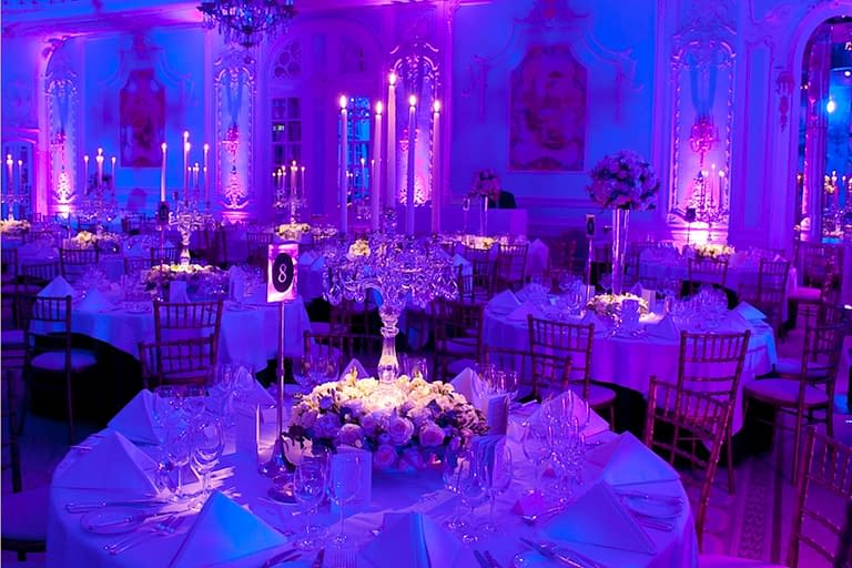 Glass table candelabra and wall uplighters at the Savoy Hotel, London wedding venue
