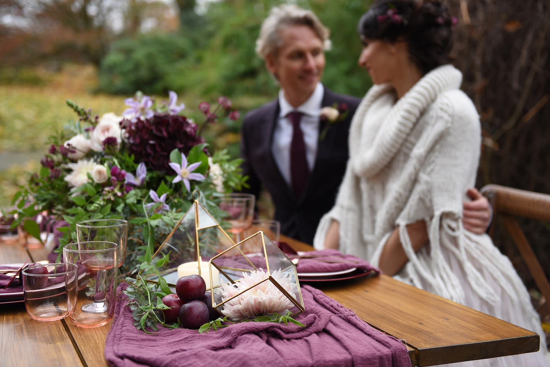 Autumnal purple wedding styled photoshoot in Wimbledon London with rustic bare top tables and copper terrarium lanterns
