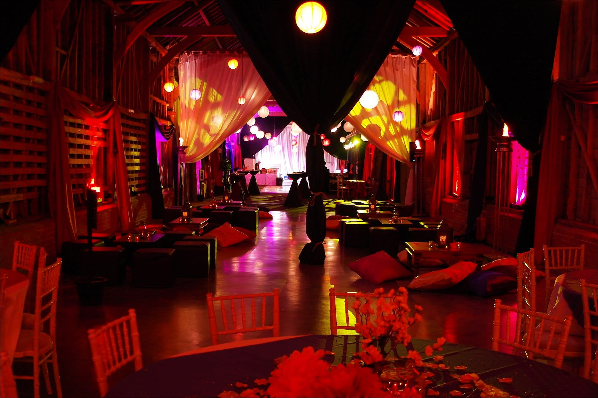 Moroccan mood lighting, lanterns and chill-out furniture at Childerley Barns UK party venue supplied by event planning company Stressfree venue transformers