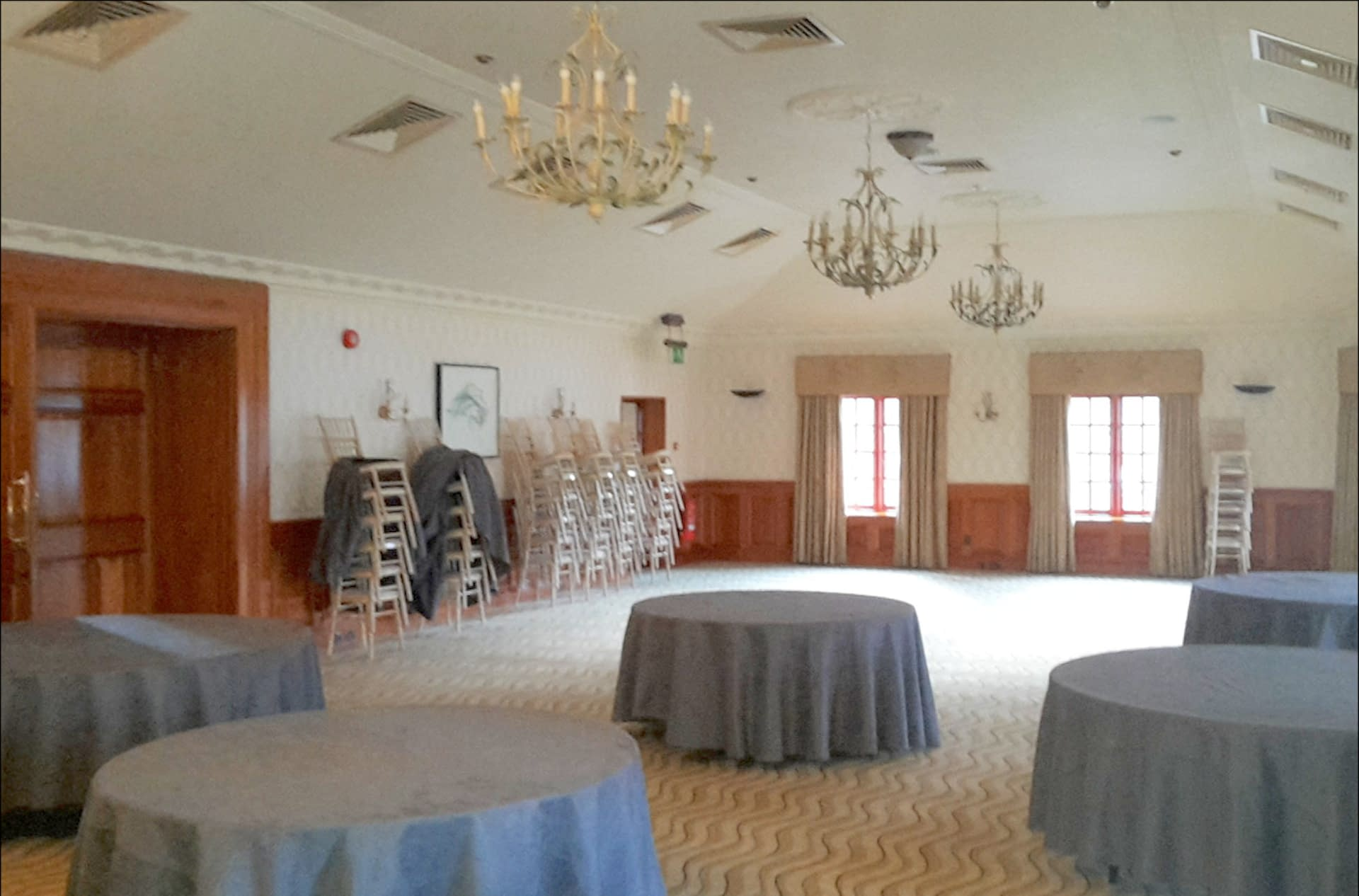 An un-decorated Balmoral Room at Pennyhill Park wedding venue UK awaiting event planning experts for a private event
