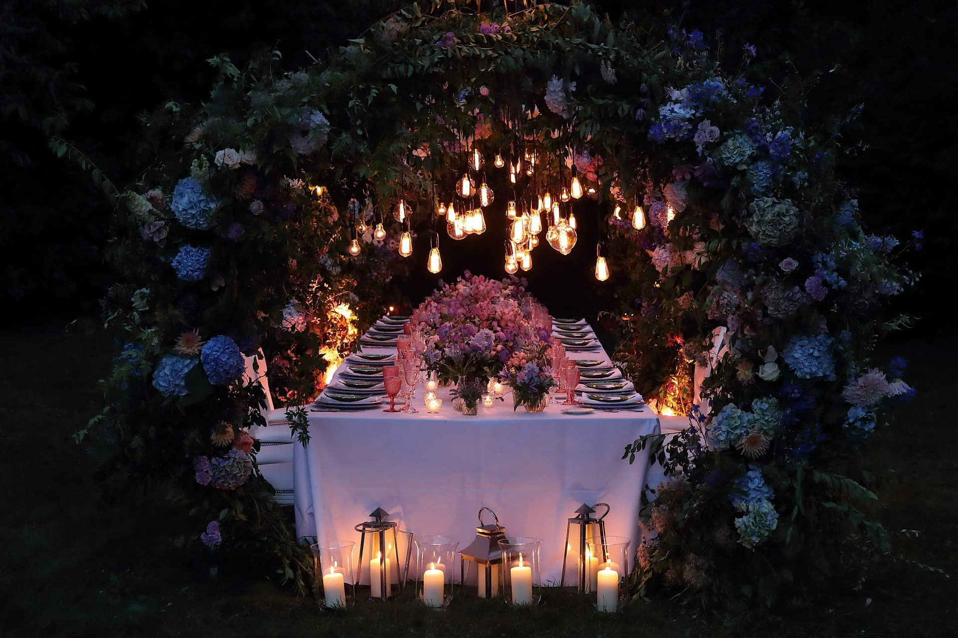 gorgeous candlelit and filament bulb installation for a secret garden party wedding styling