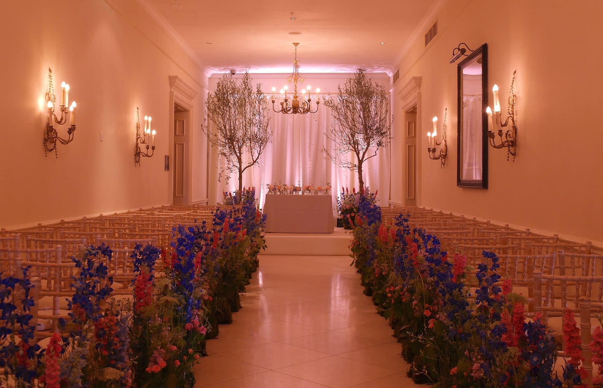 Draped backdrop and white carpeted stage at The Four Seasons Hook, UK wedding venue