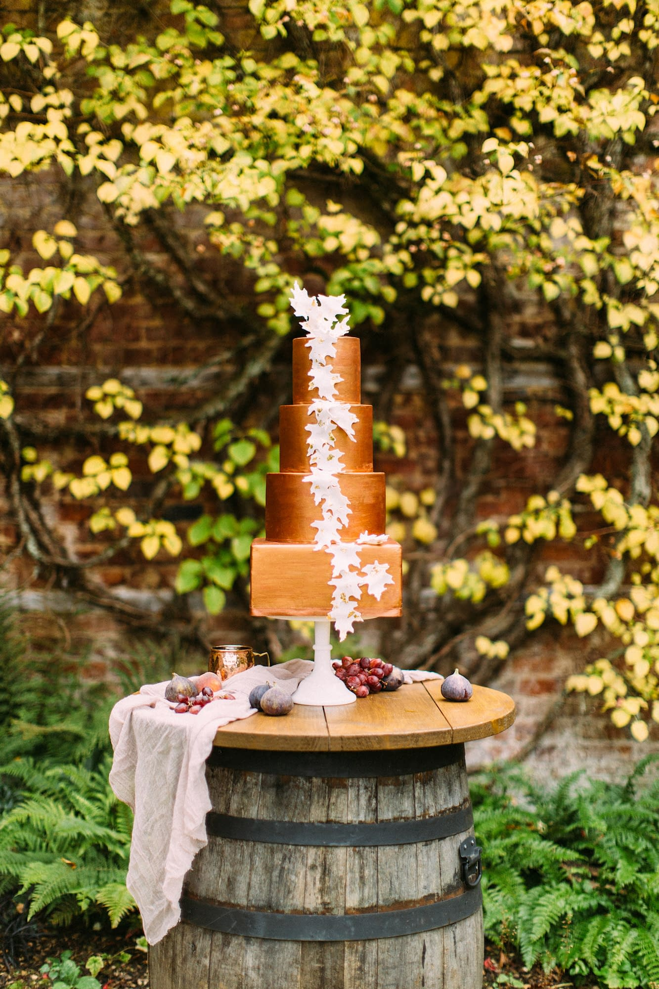 Barrel poseur table with gorgeous cake display for an autumnal wedding shoot at Farley Estate in Hampshire UK
