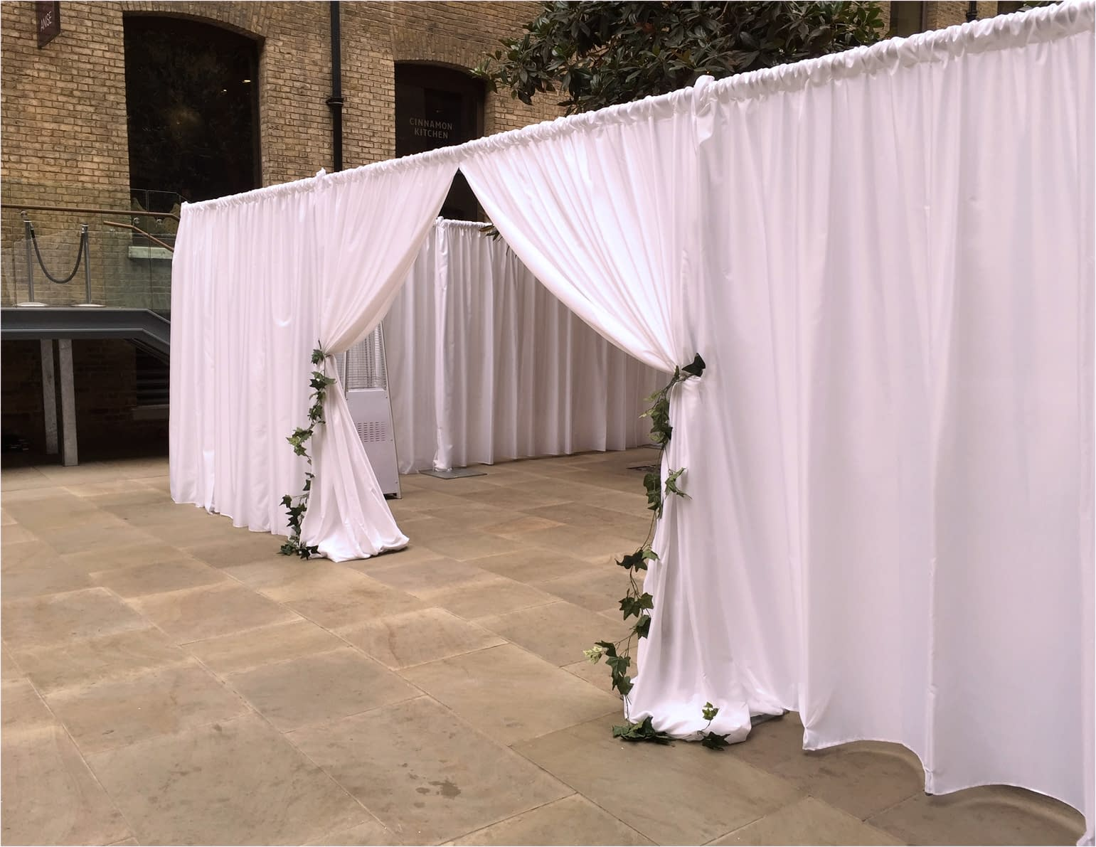 Devonshire Terrace white partition drape finished with ivy ties