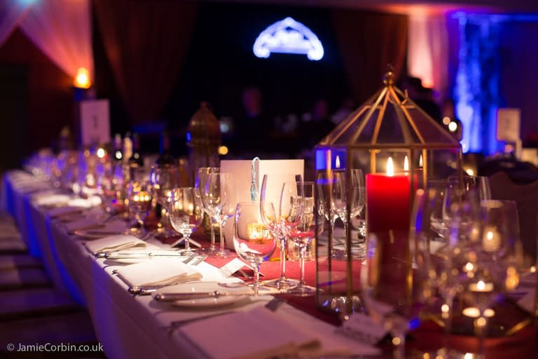 Casablanca themed event, including Ricks Cafe Americain illuminated sign, table decor and props at Hurlingham Club, London, UK party venue
