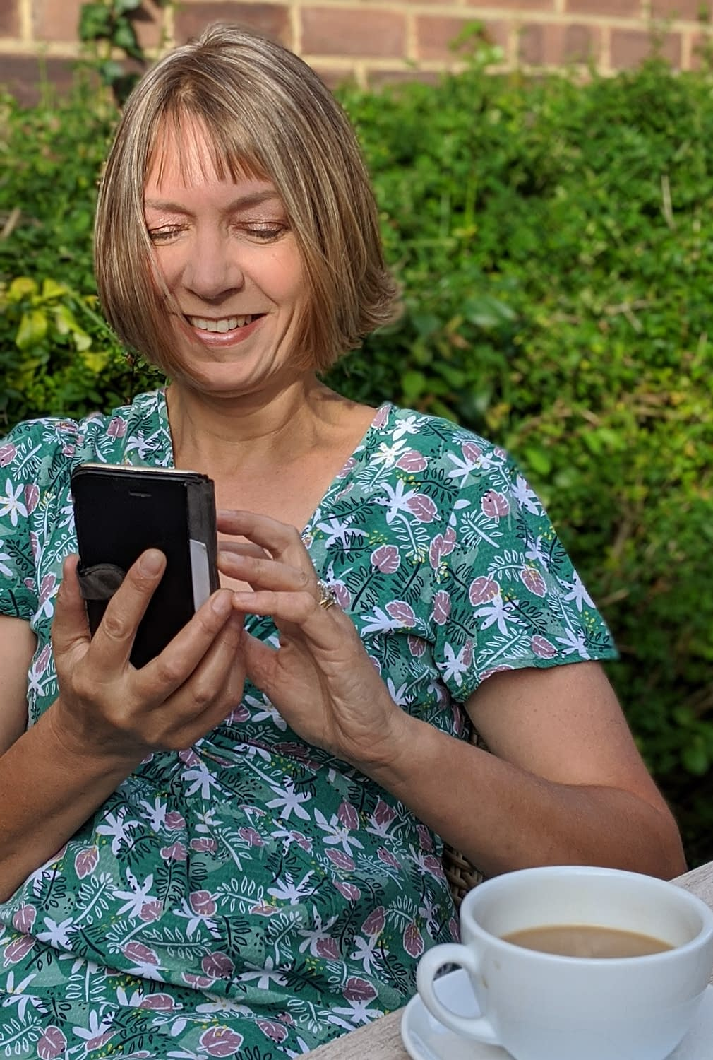Liz our MD dealing with the social media on her phone