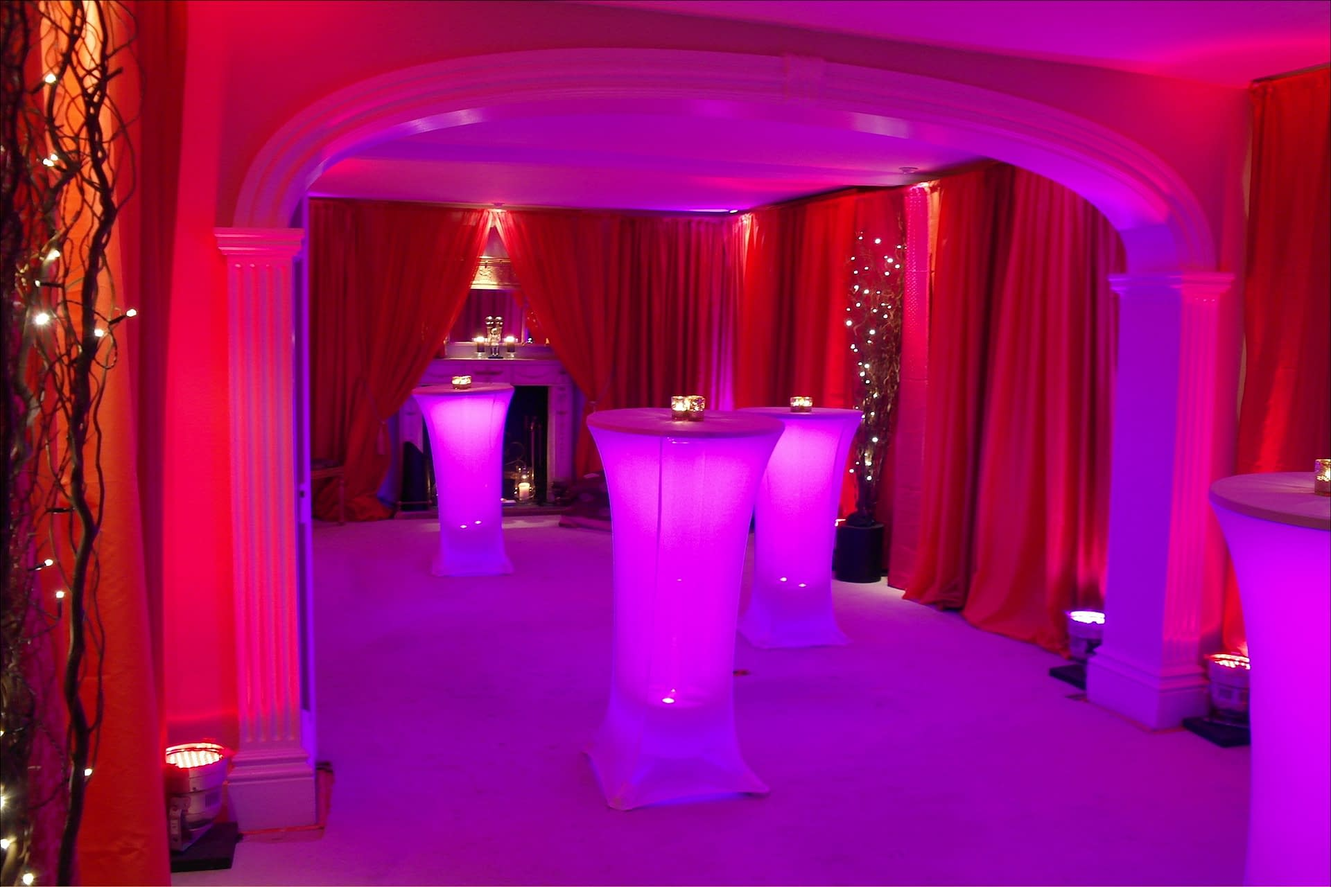 Bollywood themed party with vibrant wall drapes, lighting, furniture and props at a private house in the UK