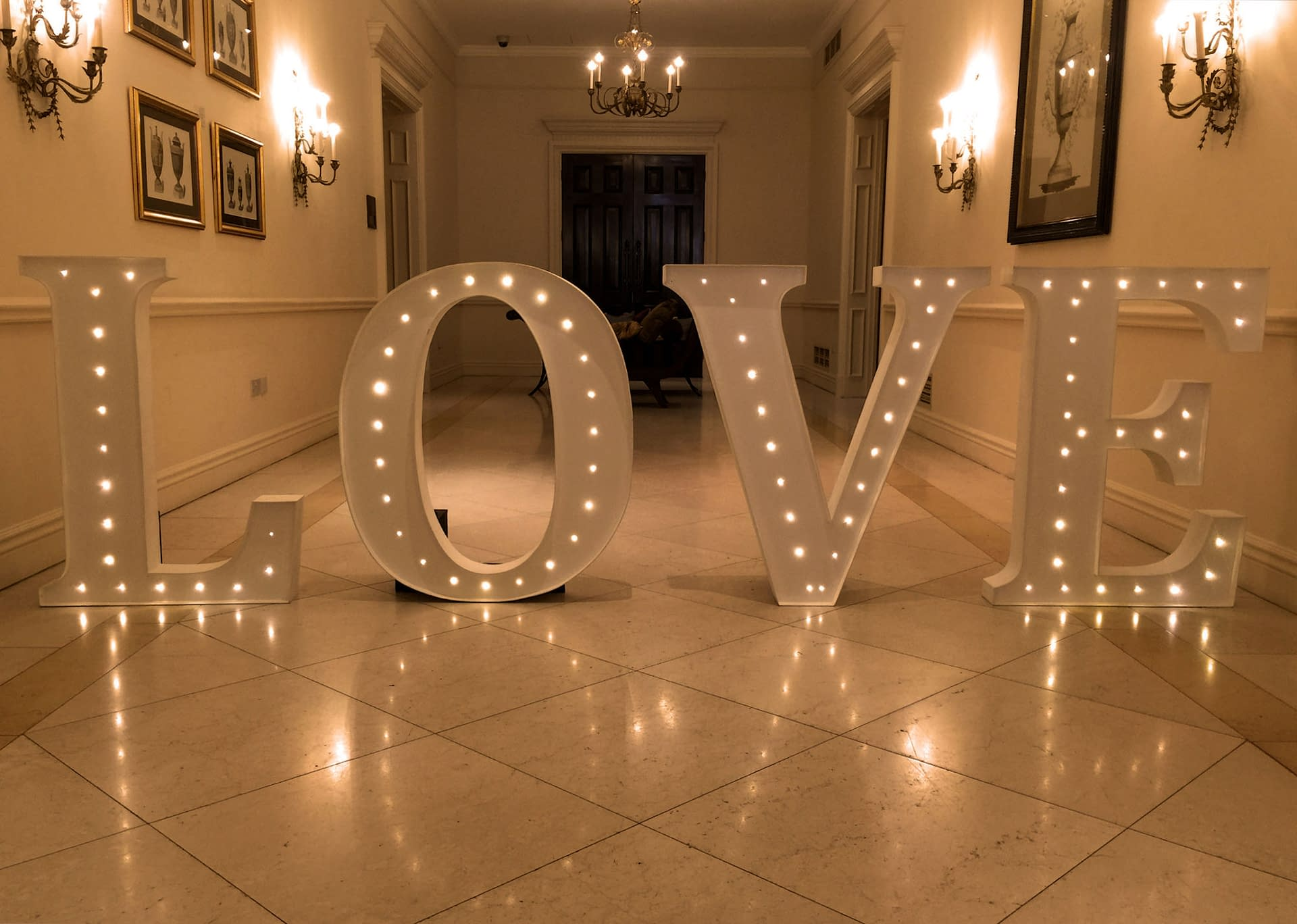 Large illuminated LOVE letters at Four Seasons Hotel in Hook, UK wedding venue