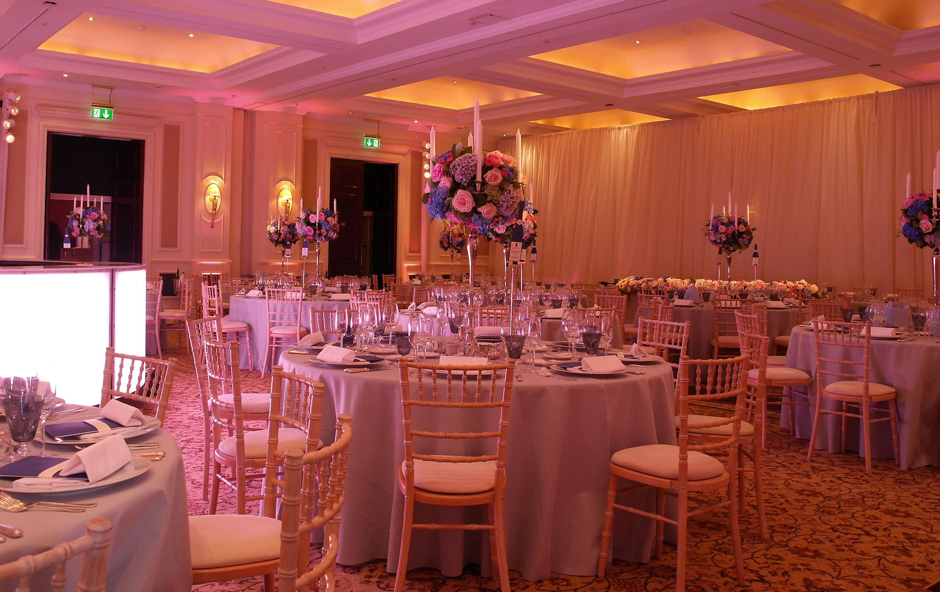 Partition drapes, mood lighting and illuminated dance floor at The Four Seasons Hook, UK wedding venue
