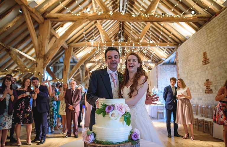 Parallel fairy light canopy at Bury Court Barn, UK wedding venue