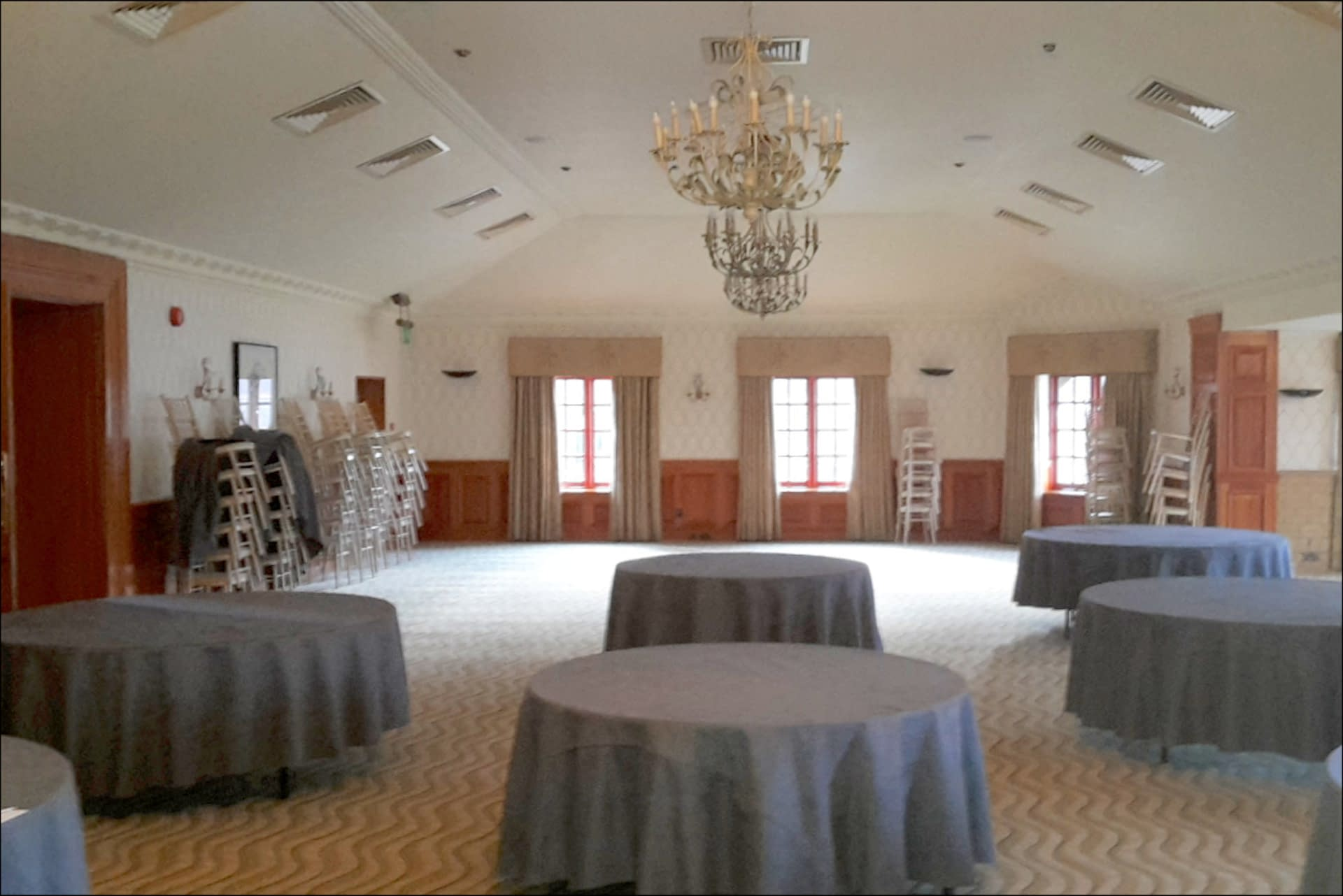An un-decorated Balmoral Room at Pennyhill Park wedding venue UK