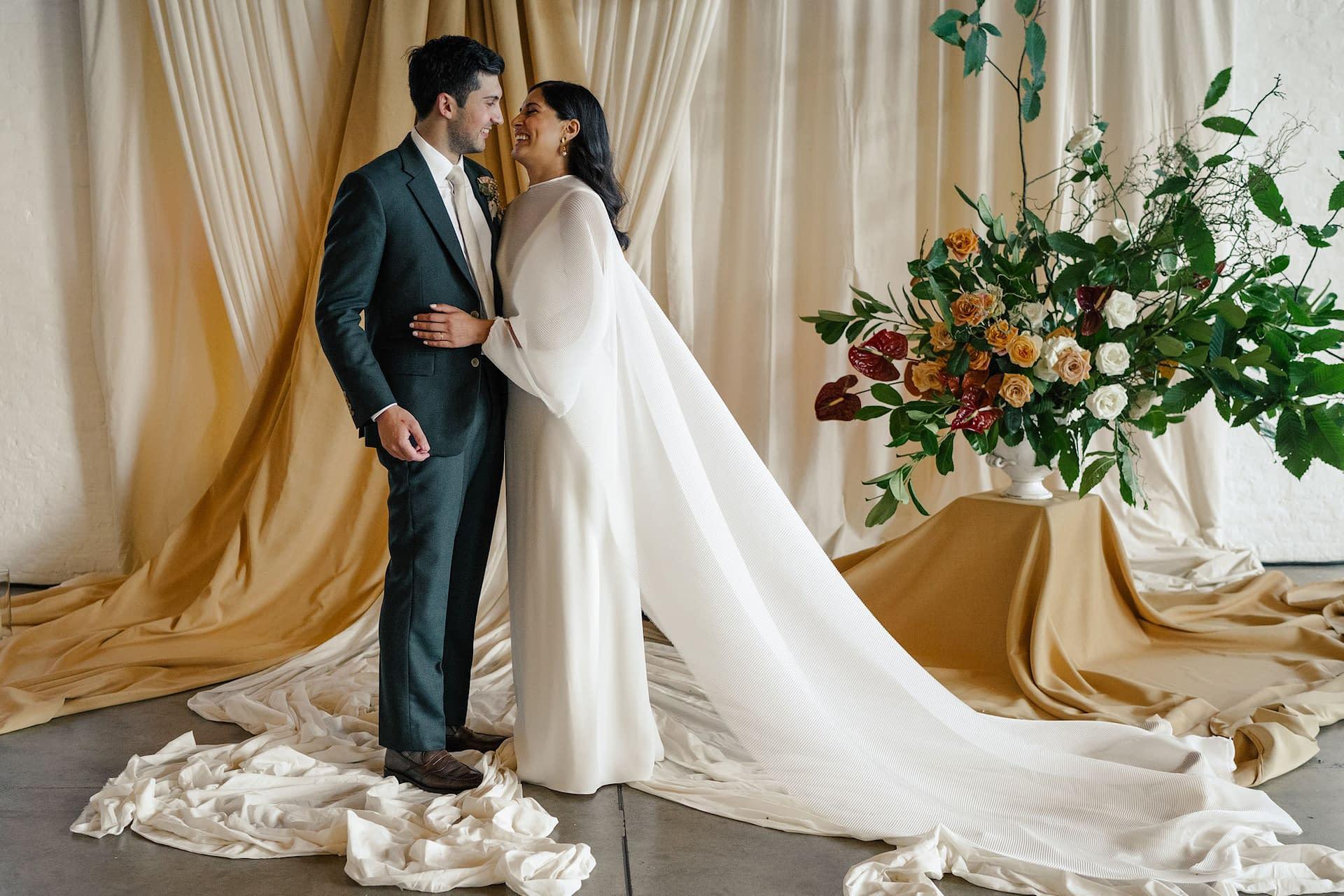 Bespoke fabric backdrop for a wedding at Trinity Buoy Wharf, London wedding venue